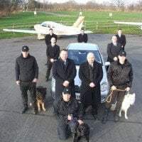 VIP protection team with two protection dogs and explosive detection dog